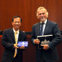 Crescenzio Rivellini, Chairman of Delegation for Relations with the People's Republic of China of the European Parliament (R) exchanges gifts with Jasper Tsang, President of the Legislative Council of Hong Kong the brand-new Legislative Council Building. - 5th September 2011