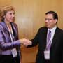 Connie Hedegaard, European Commissioner for Climate Action is greeted by Anthony Cheung, Hong Kong Consumer Council Chairman at the Consumers International World Congress