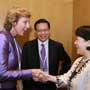Connie Hedegaard, European Commissioner for Climate Action is greeted by Connie Lau, Chief Executive of Hong Kong Consumer Council at the Consumers International World Congress