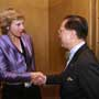 Connie Hedegaard, European Commissioner for Climate Action is greeted by Donald Tsang, Chief Executive for Hong Kong SAR at the Consumers International World Congress