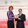 Connie Hedegaard, European Commissioner for Climate Action receives a souvenir from Anthony Cheung, Hong Kong Consumer Council Chairman at the Consumers International World Congress