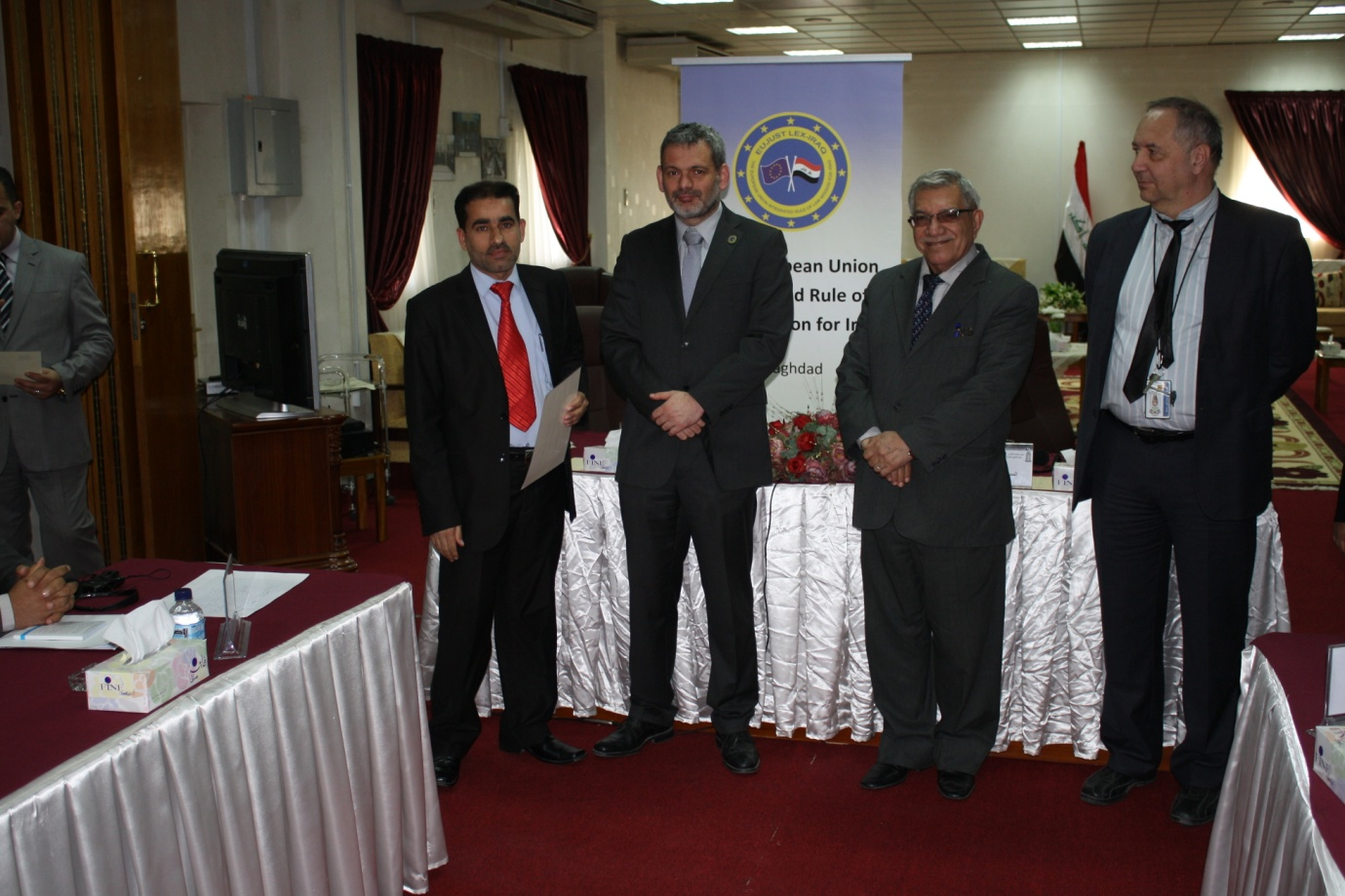 A participant receiving his certificate from EJL-I Head of Mission, László Huszár, watched by Judge Fathi al-Juari and EJL-I judiciary team leader Anton Girginov