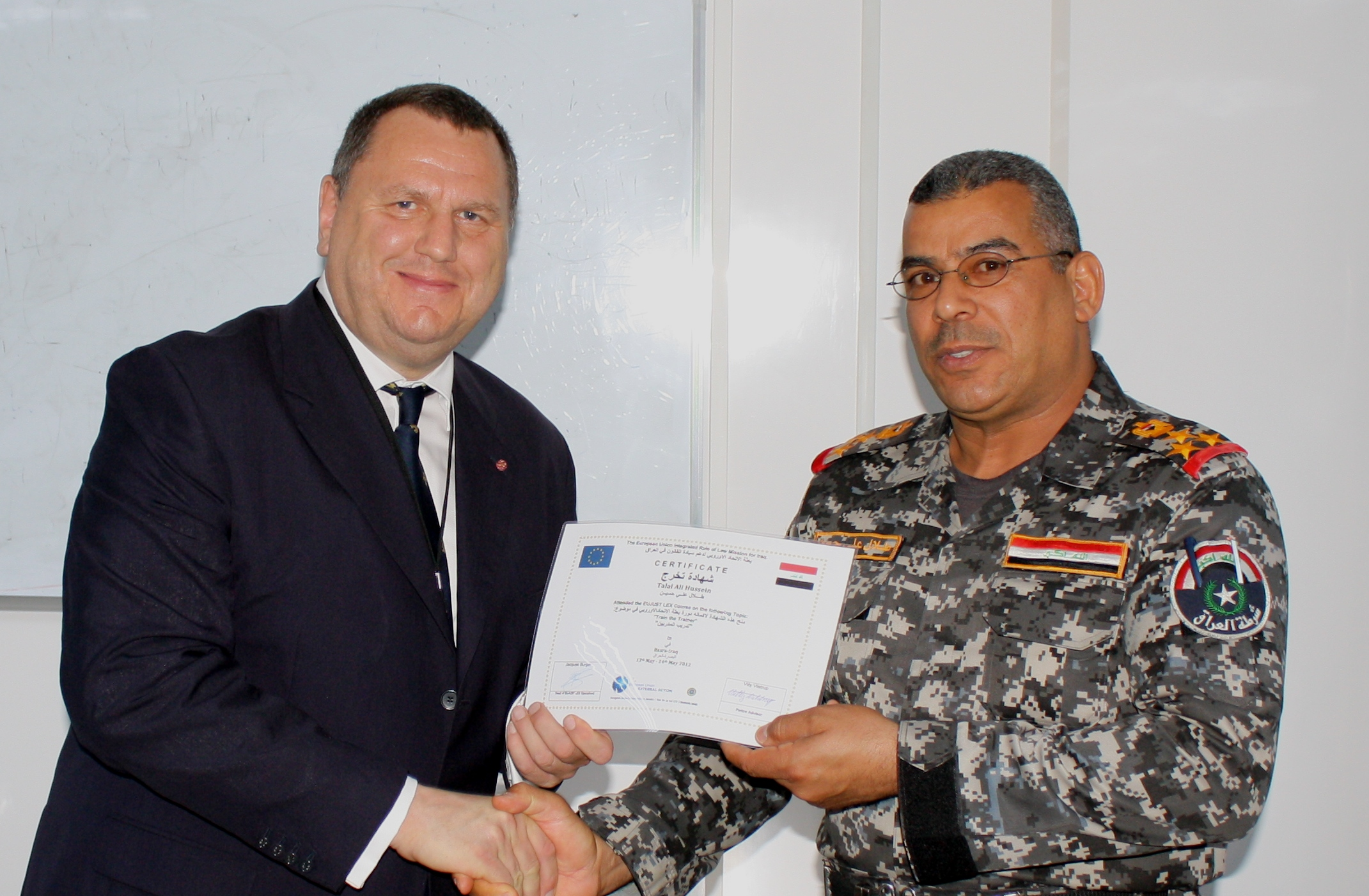 Police Team Leader Robert Lamburne and the Dean of the Shaiba Police College Brigadier General Talal