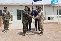 Gen. AHERNE passing the EU flag to Gen. MINGIARDI
