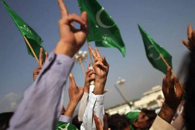 Pakistani flags and hands forming the peace sign