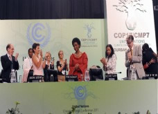 Closing moments of COP17/CMP7 as COP President Maite Nkoana-Mashabane receives a standing ovation © IISD RS