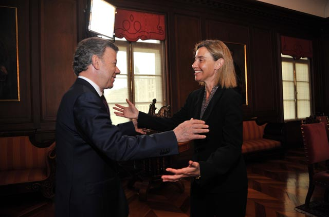 Photo caption: Colombia's President Juan Manuel Santos (left) welcomes Federica Mogherini during h